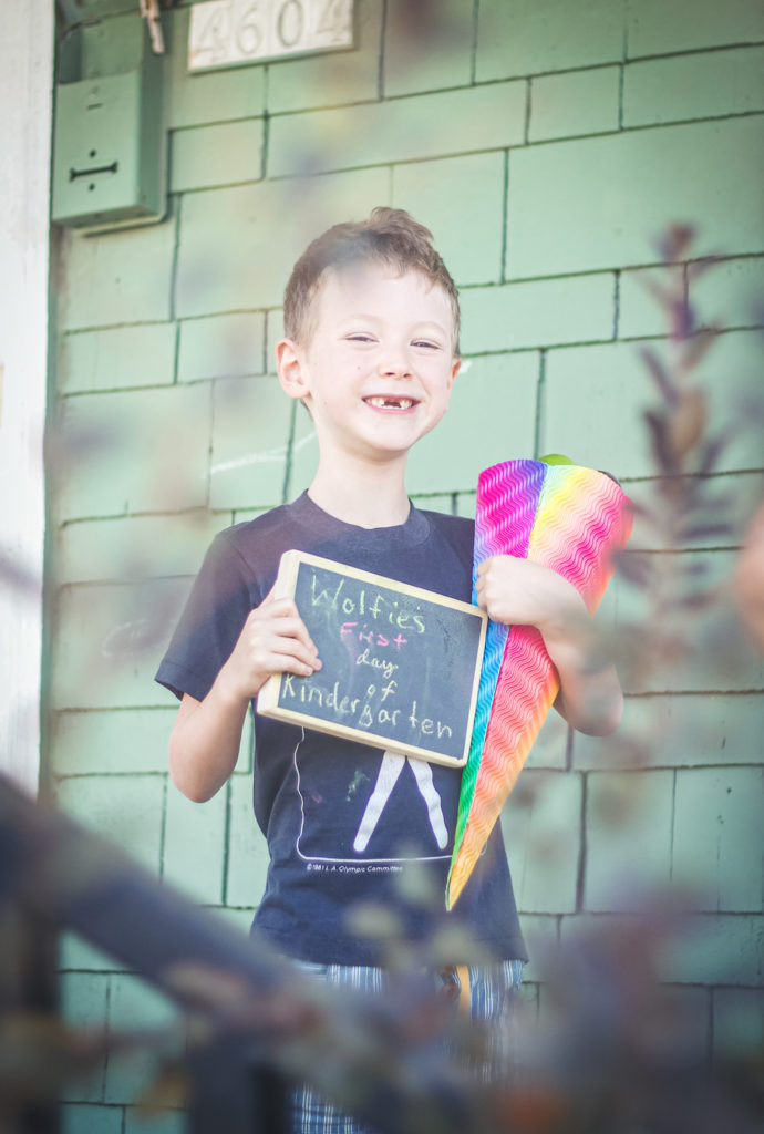 boy missing front teeth first day of kindergarten
