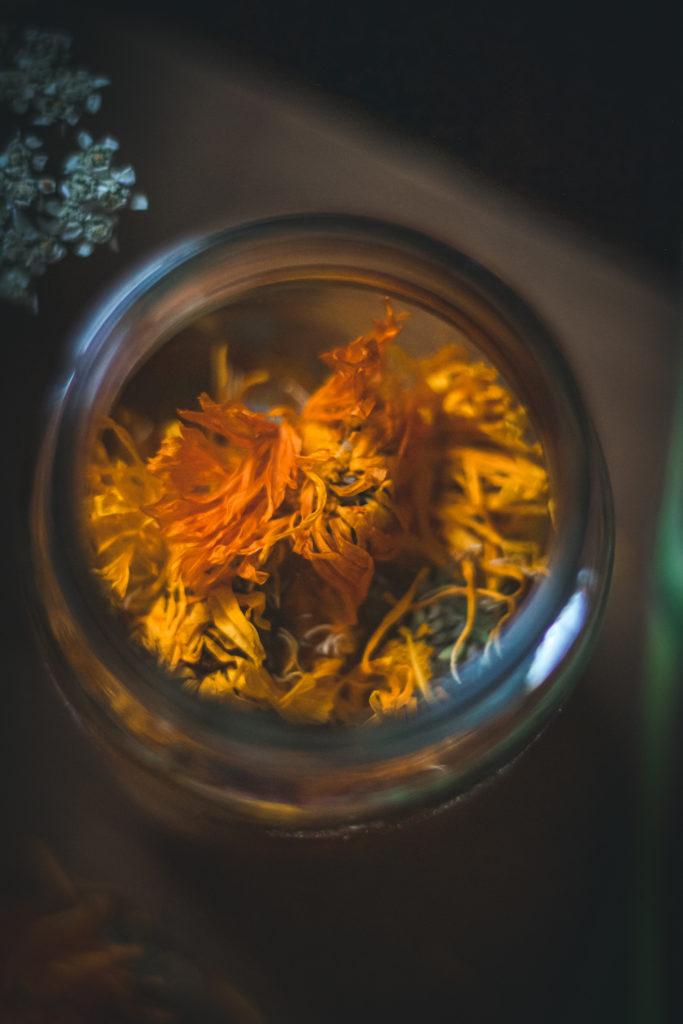 dried calendula blossoms in jar
