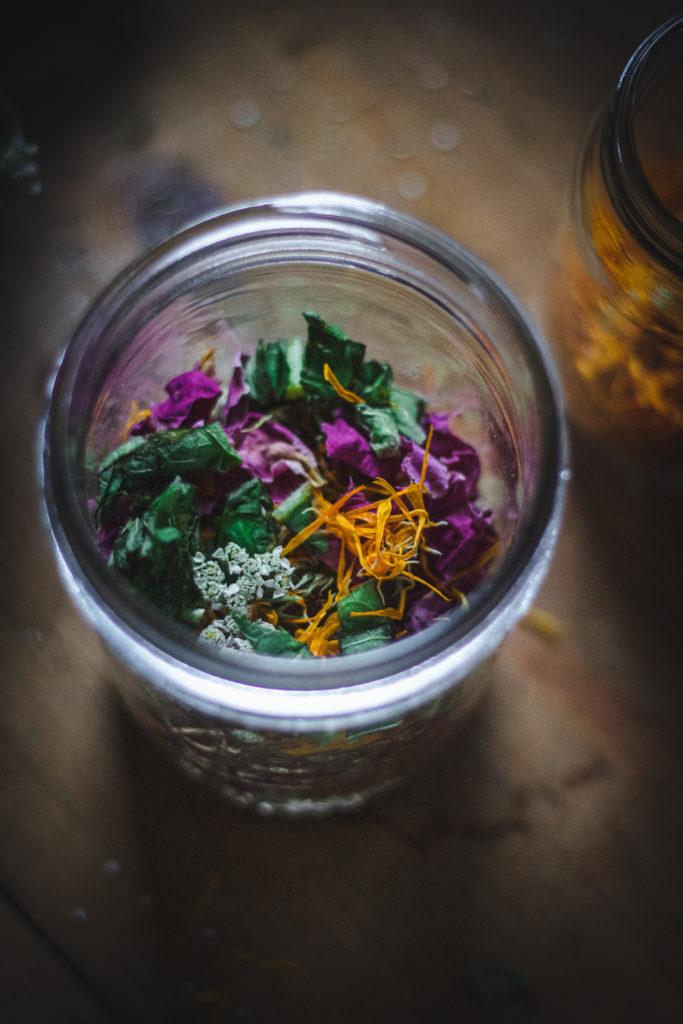 herbs in jar for herbal oil