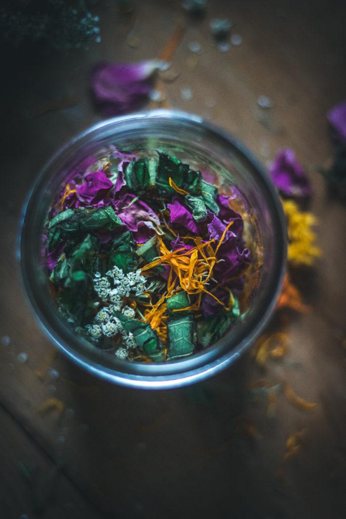 calendula rose comfrey yarrow plantain herbs in jar for herbal oil