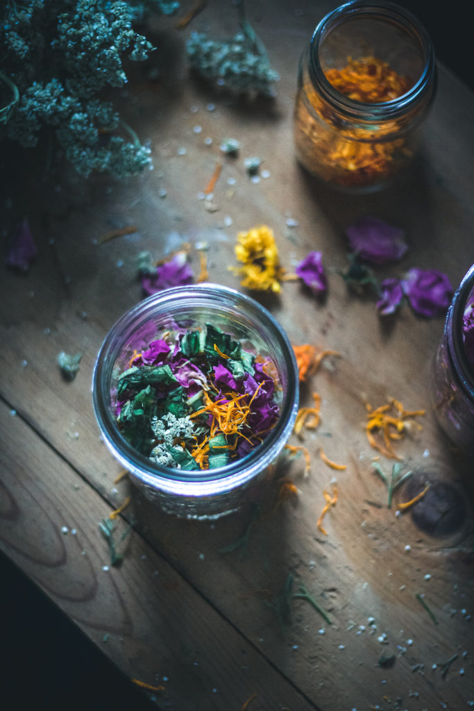 herbs in a jar to make herbal oil