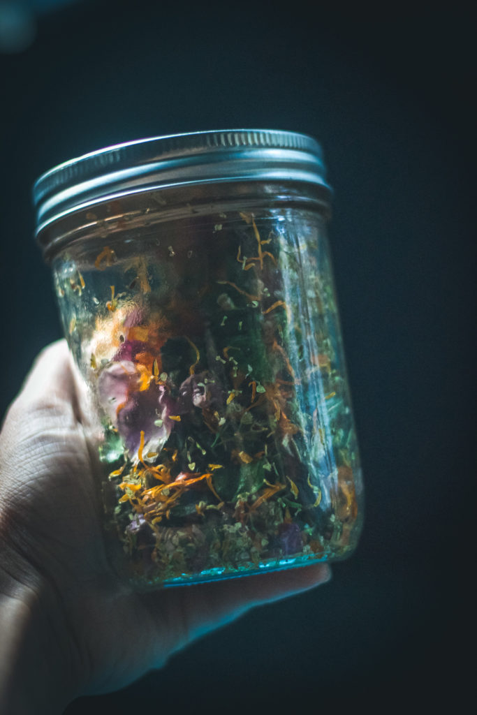 herbs in jar with alcohol