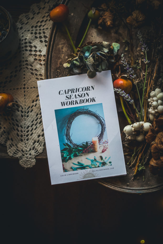capricorn season workbook with dried flowers lace and herbal tea