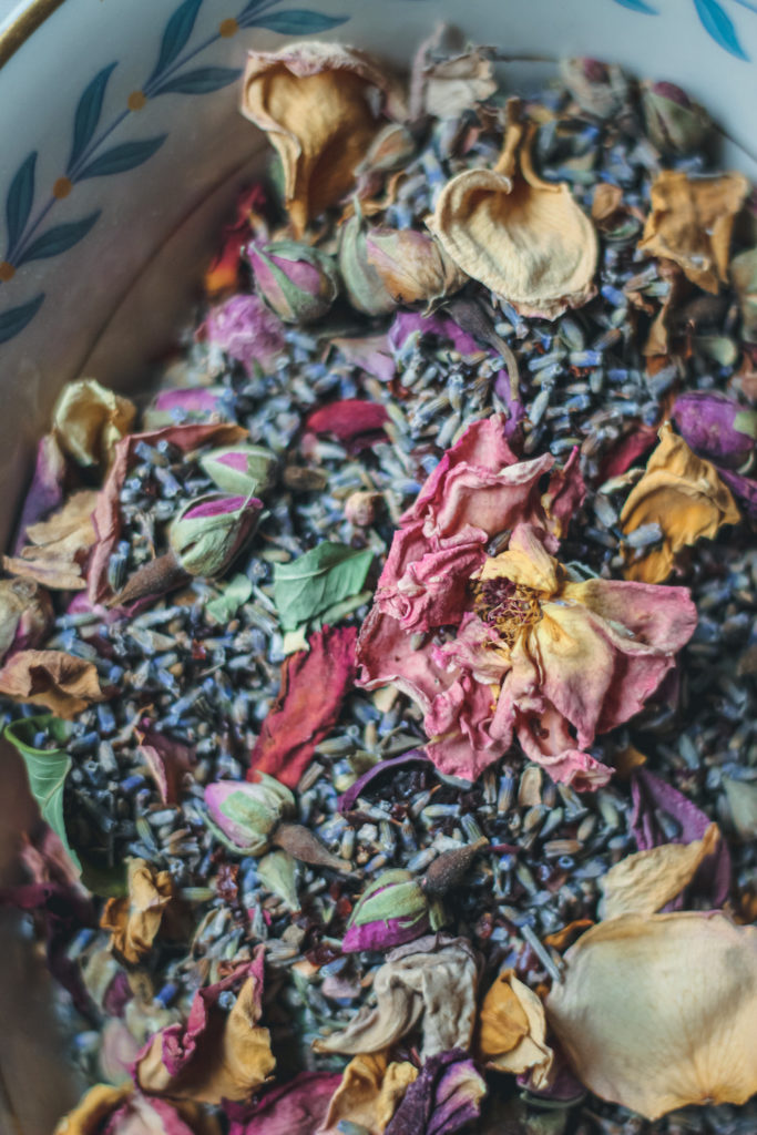 close up of dried yellow and pink rose  and lavender herbal tea