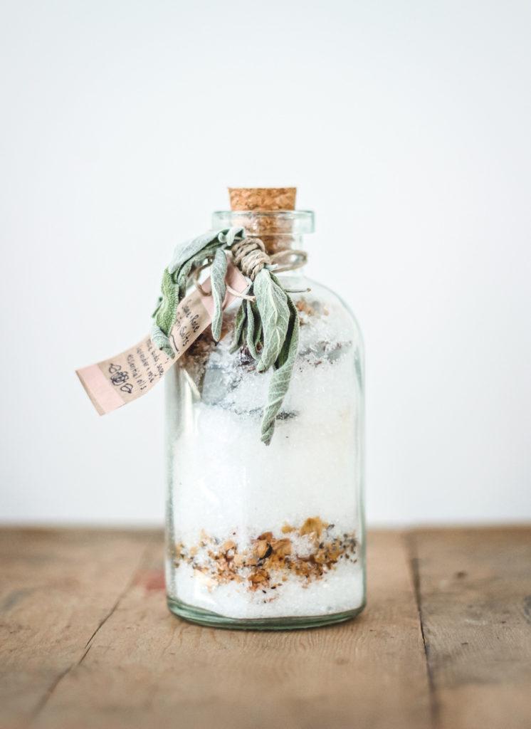 salt soak in a glass jar with herb