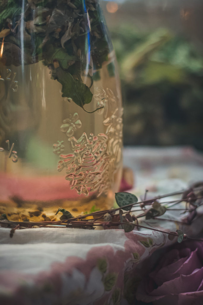 skullcap lavender rose tea steeping in a glass jar