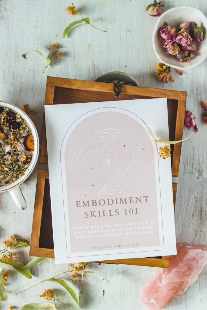 embodiment skills workbook with roses and herbal tea in tea cup