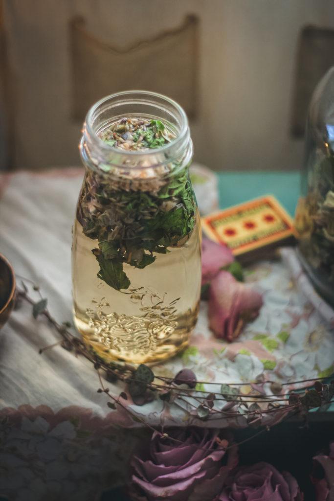 skullcap lavender rose tea steeping in glass jar