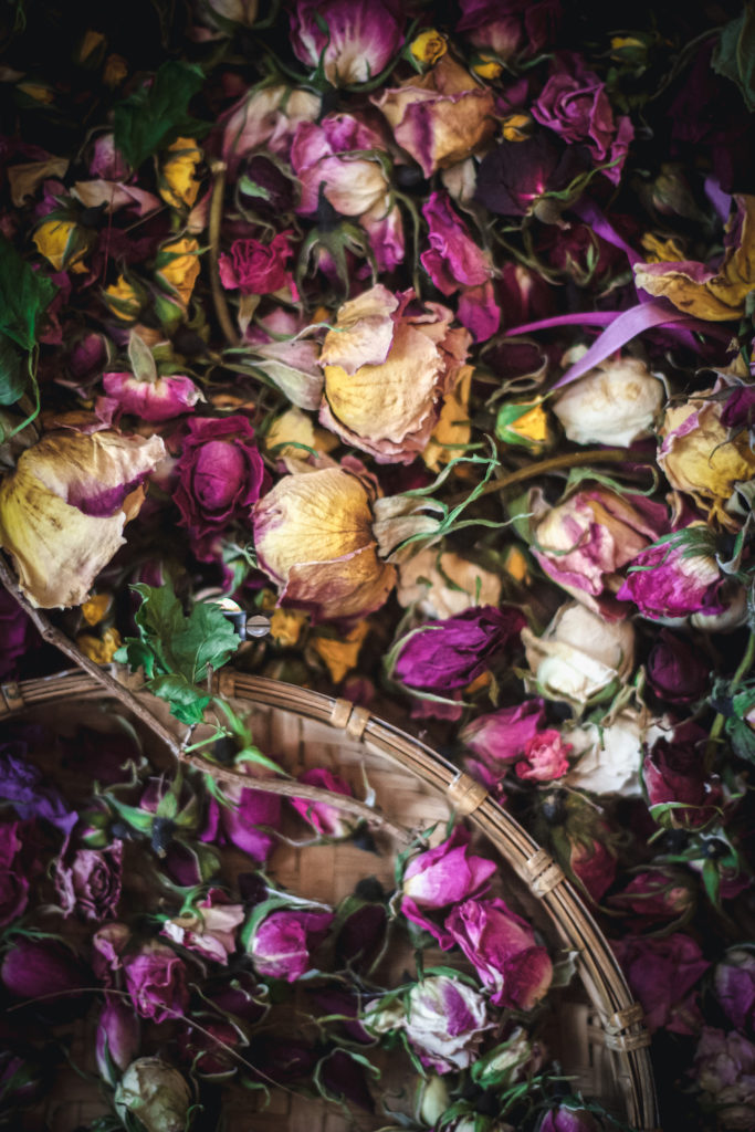 dried roses of all colors in baskets
