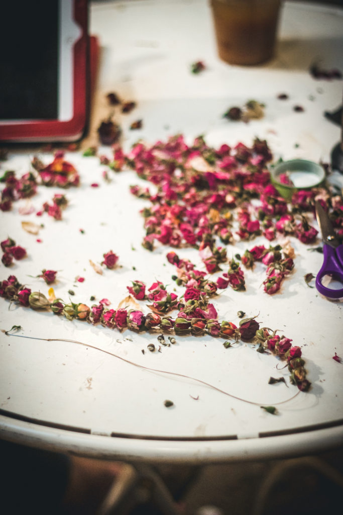 rosebuds being worked onto a string