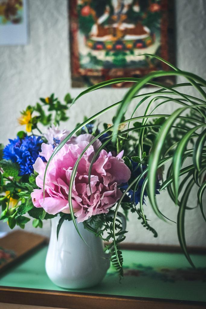 pink peony arrangement spider plant
