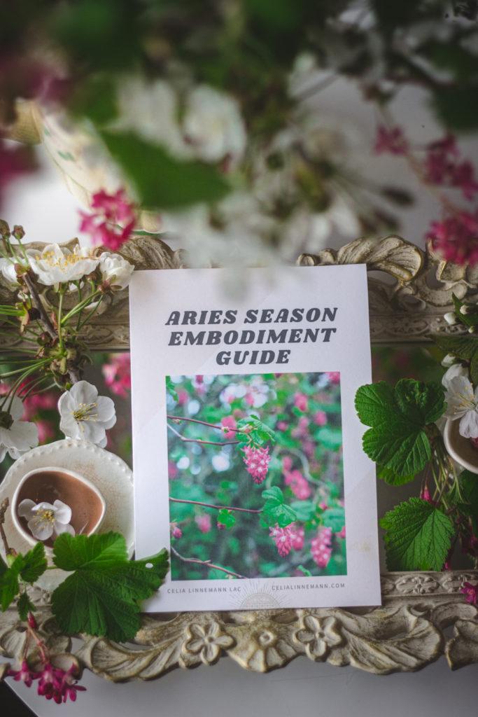 aries season embodiment guide flat lay
