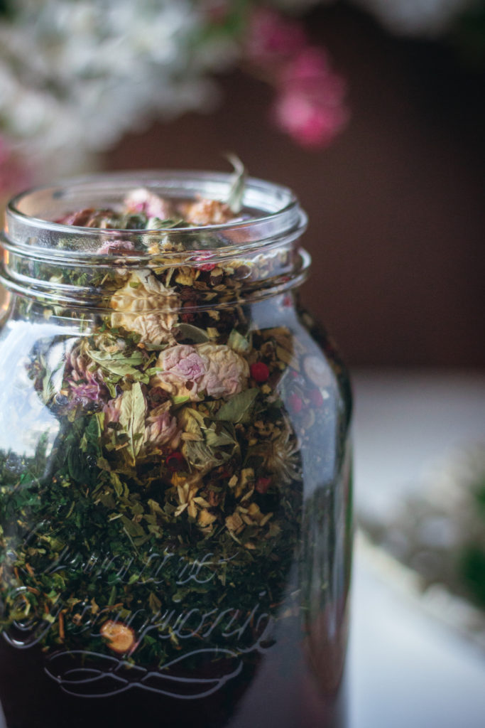 herbal tea steeping in jar close up