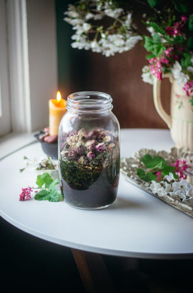nettle tea halfway full steeping in a jar