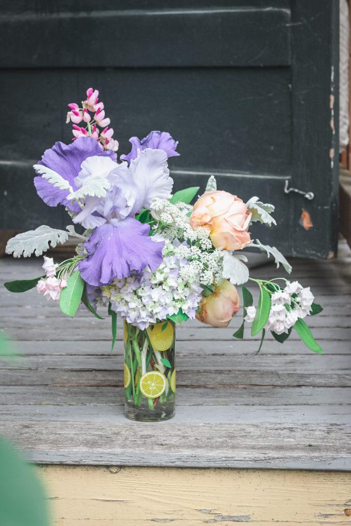 iris peach rose arrangement