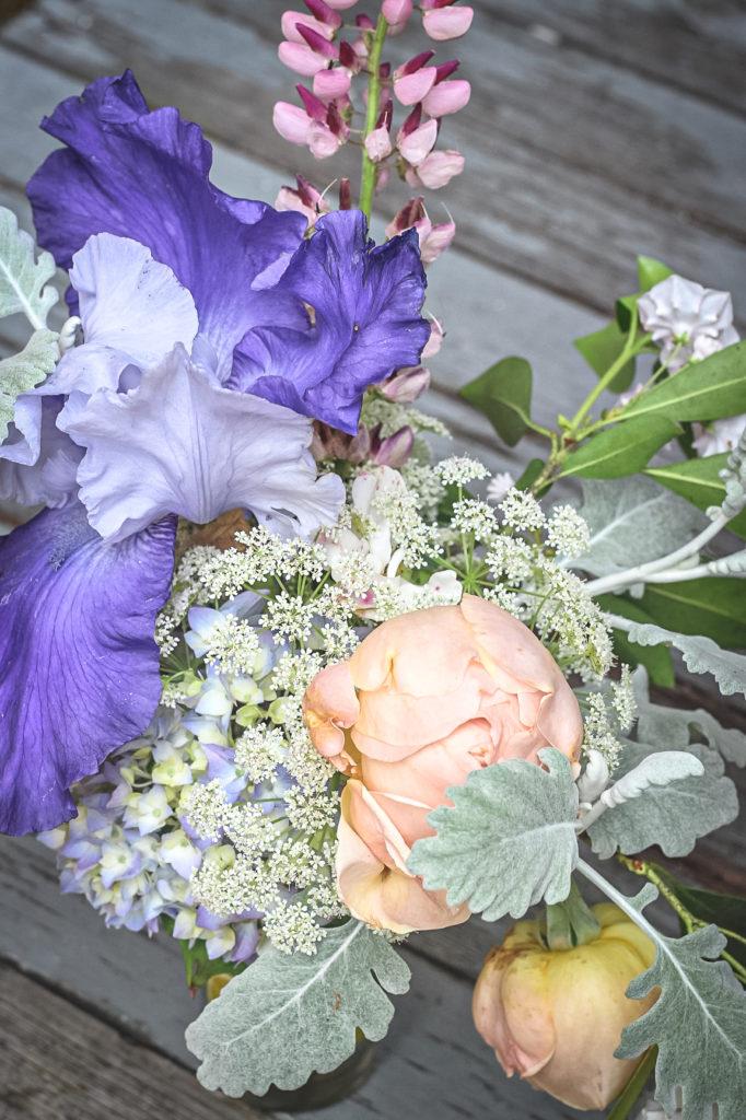 blue iris peach rose arrangement