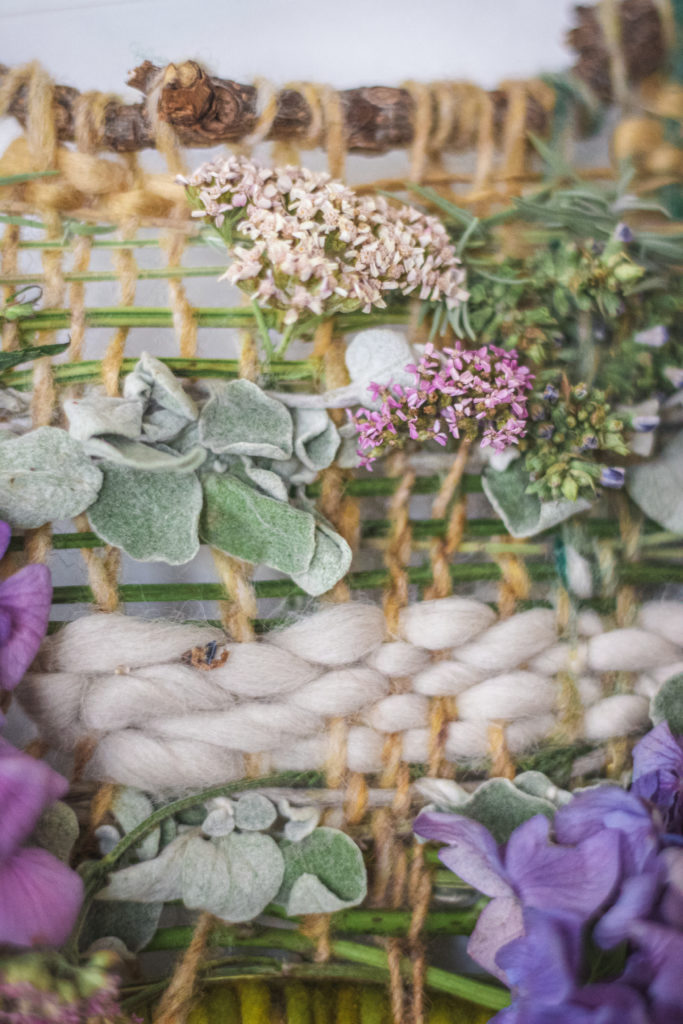 close up on nature weaving with yarn and plants