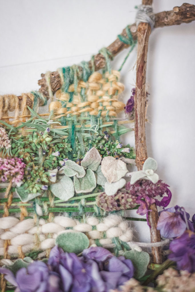 detail of nature weaving with plants and yarn